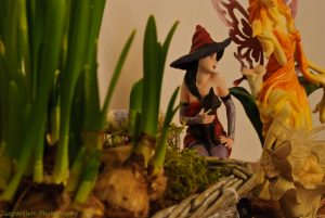 Witch Behind Flowers